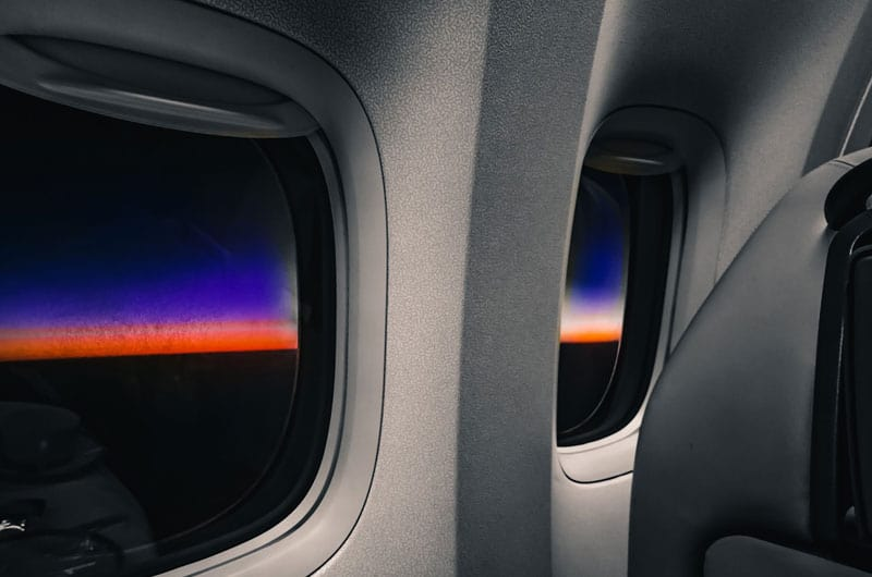 airplane window at sunrise
